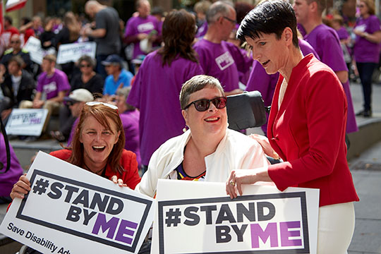 Kate Washington MP and Liesl Tesch MP holding Stand By Me signs
