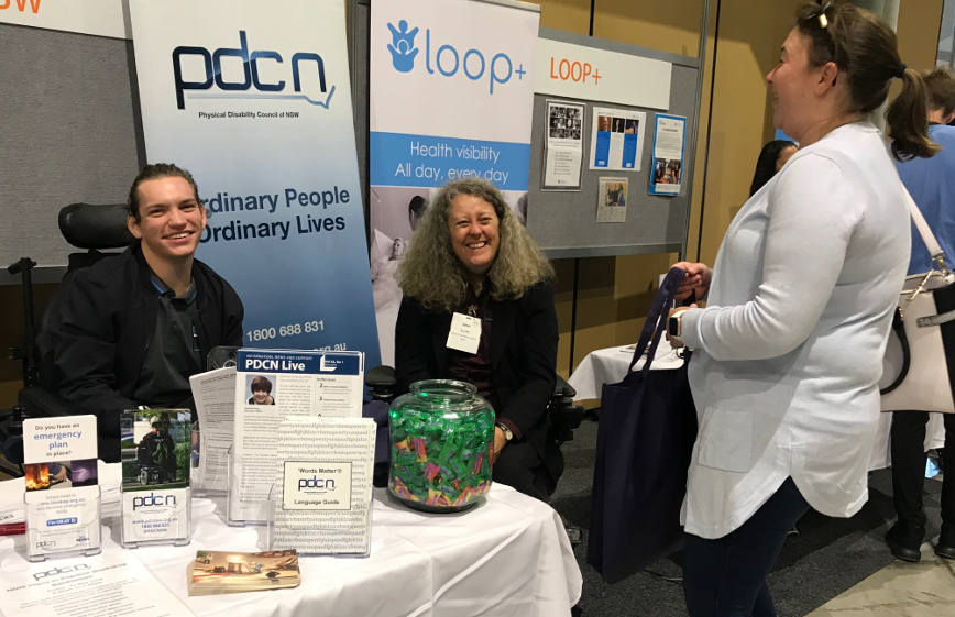 PDCN Board Member Jacob Cross, with Peer Support Project Officer Jane Scott and a member of the public at the ATSA Independent Living Expo.