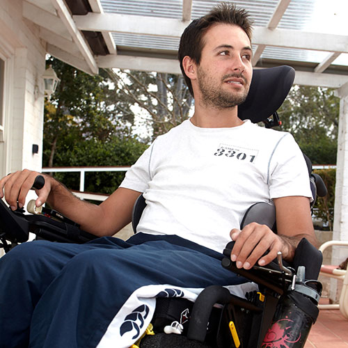 Man using motorised wheelchair on his porch