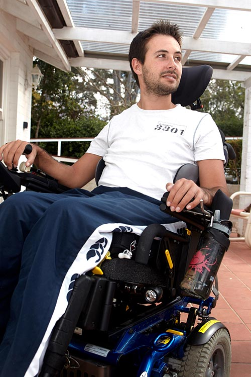 Man using motorised wheelchair on his porch