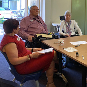Participants on PDCN consultation with people with disability sit around a table talking